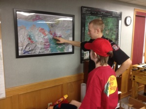 My youngest Hayden is shown the historical fire damage in the region by a young firefighter